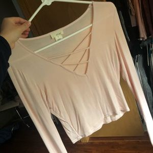 I am selling a sweet pink crop top